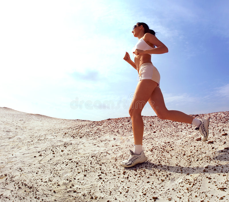 Download Teen Lady Running On Sand Royalty Free Stock Photo - Image: 3347205
