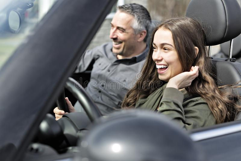 Teen learning to drive or taking driving test. A Teen learning to drive or taking driving test stock images