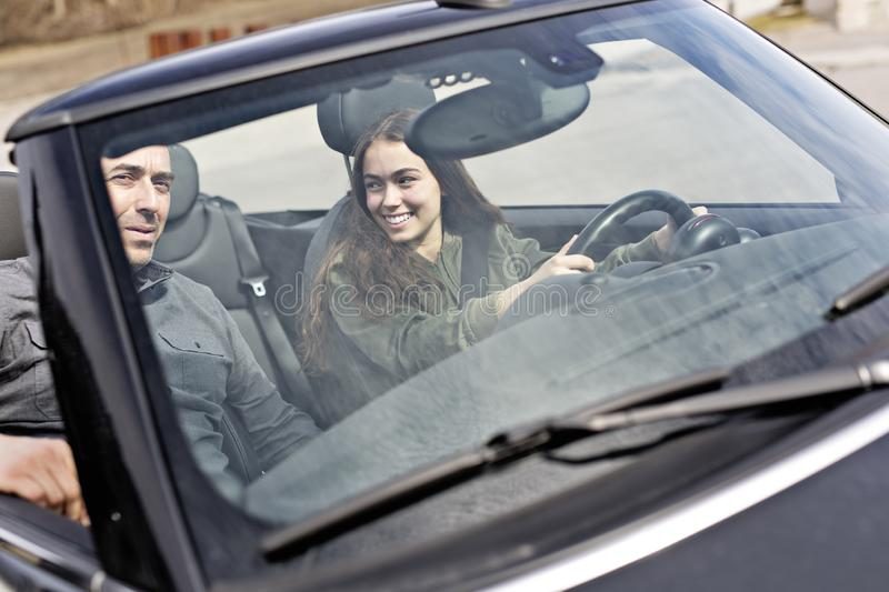 Teen learning to drive or taking driving test. A Teen learning to drive or taking driving test stock photography