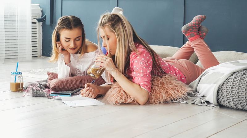 Teen leisure girls hanging out floor home drawing royalty free stock images