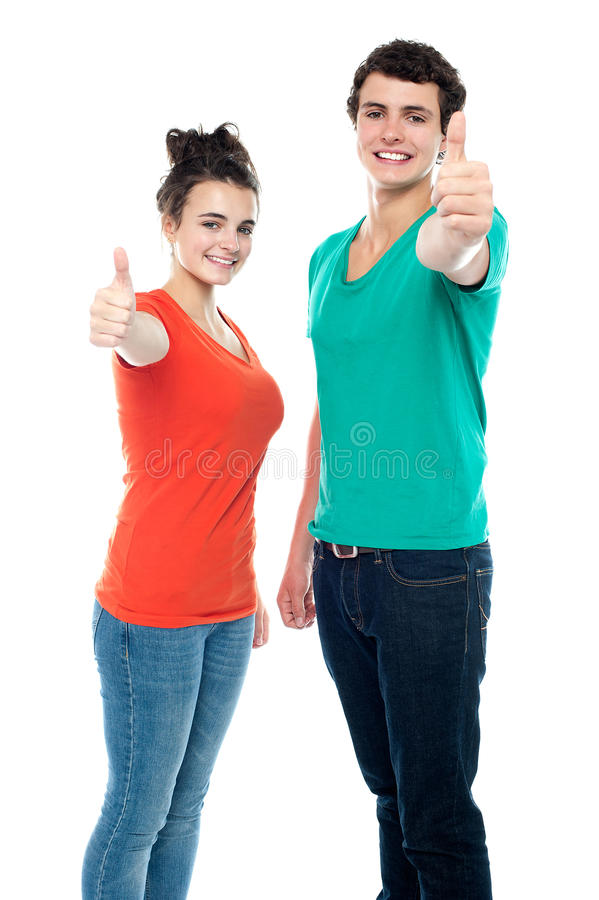 Teen love couple showing thumbs up to camera