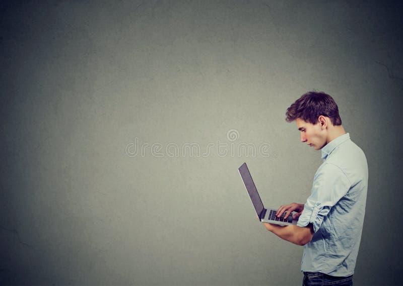 Teen man using laptop computer royalty free stock photos