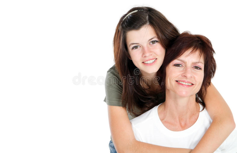 Teen and mom. Middle aged mom and teen daughter portrait in studio