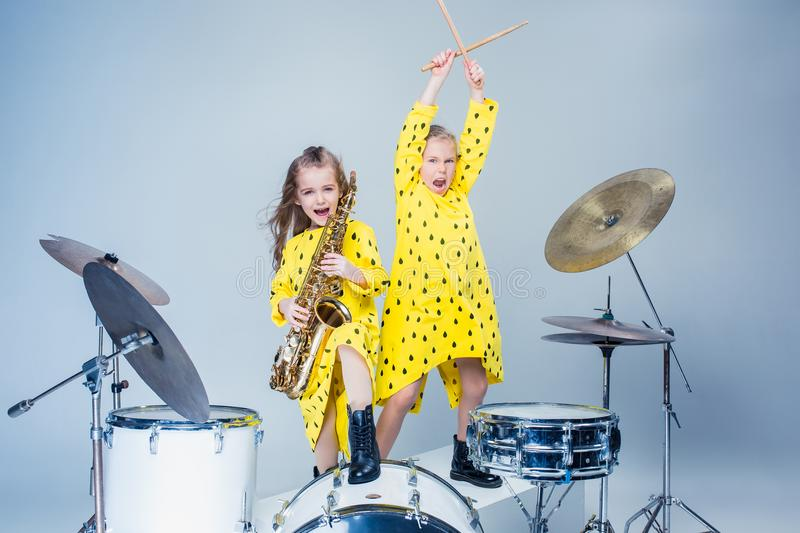 The teen music band performing in a recording studio. Teen music girls performing in a recording studio. The group of two girls standing together. Studio royalty free stock photo