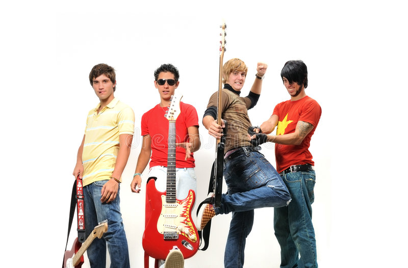 Teen musical band. Portrait of young trendy teenager group posing with musical intruments royalty free stock photo
