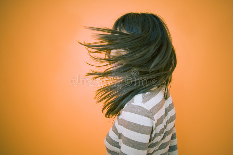 Teen Obscured By Blowing Hair royalty free stock images