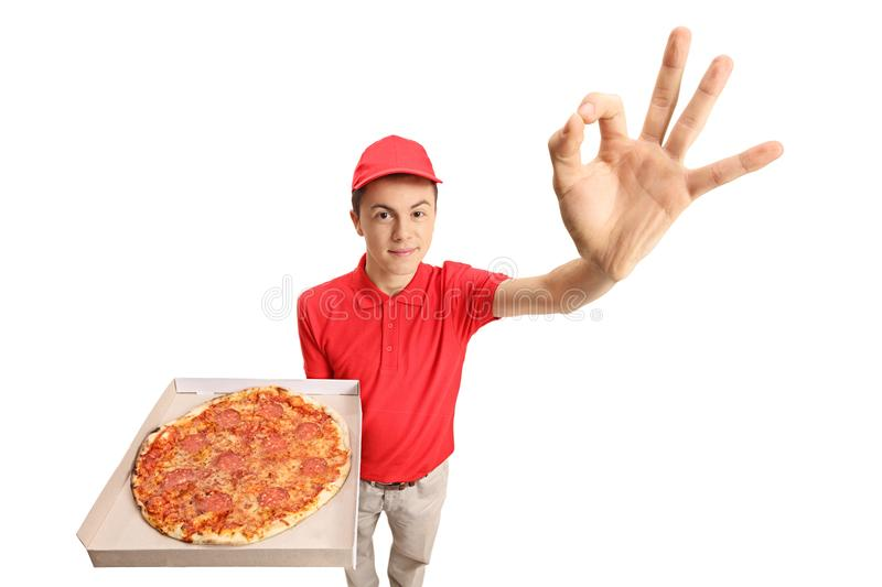 Teen pizza delivery boy making an ok gesture. Isolated on white background stock photos