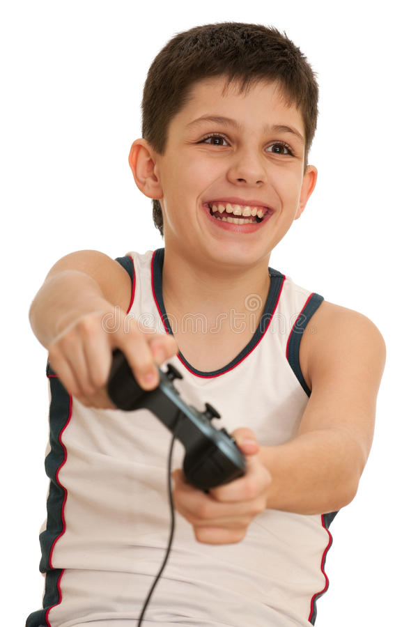 Teen playing a computer game with joystick. A kid is holding a joystick in his hands; isolated on the white background stock photos