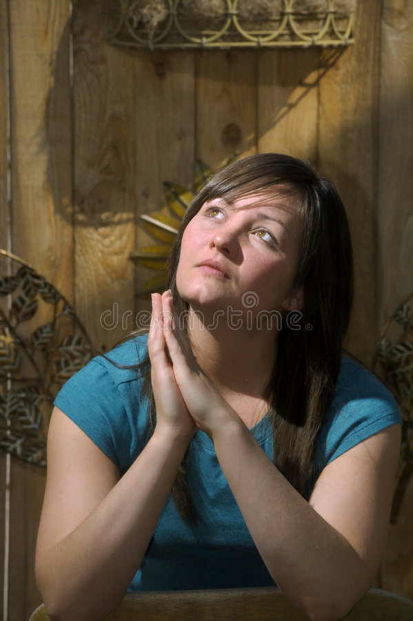 Teen Prays By Garden Fence Stock Image