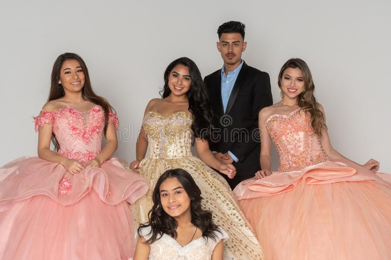 Teen Quinceanera Dresses. Group of teens with their quinceanera dresses on royalty free stock photography