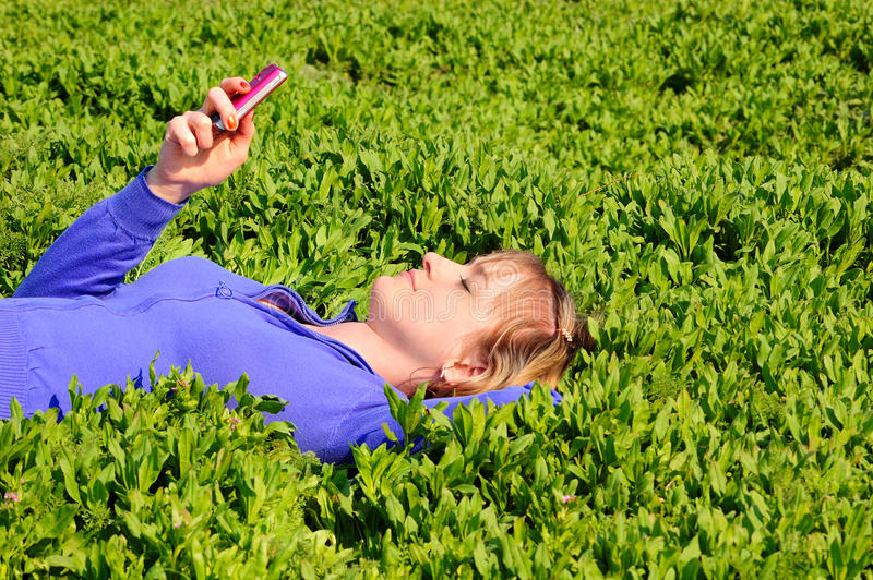 Download Teen reads sms stock photo. Image of connectivity, grass - 12666486