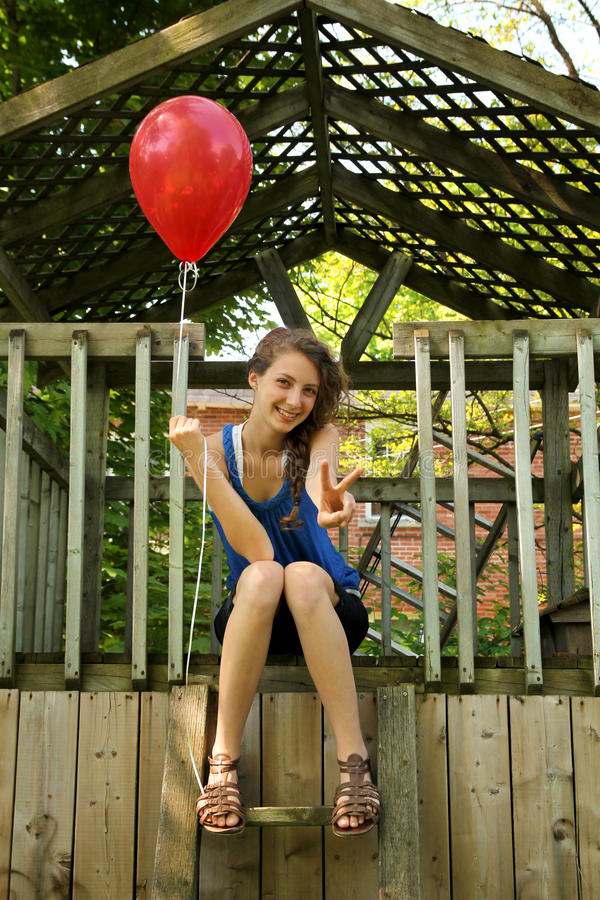 Teen with red balloon stock photography