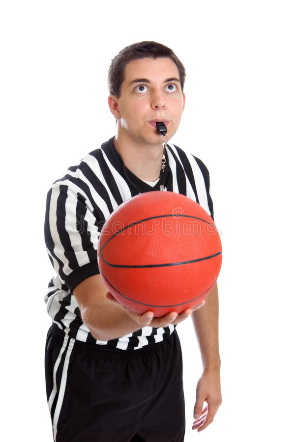 Teen referee. Teenage basketball referee about to toss the ball in the air isolated on a white background royalty free stock images