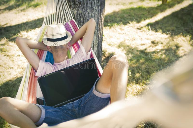 Teen Relaxing In A Hammock stock image