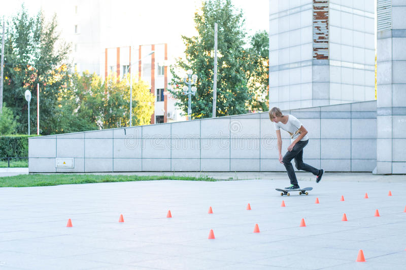 Teen rides a skateboard royalty free stock images