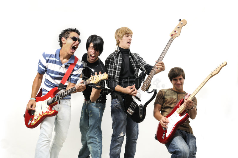 Teen rock band. Portrait of young musical band playing with instruments - isolated royalty free stock photography