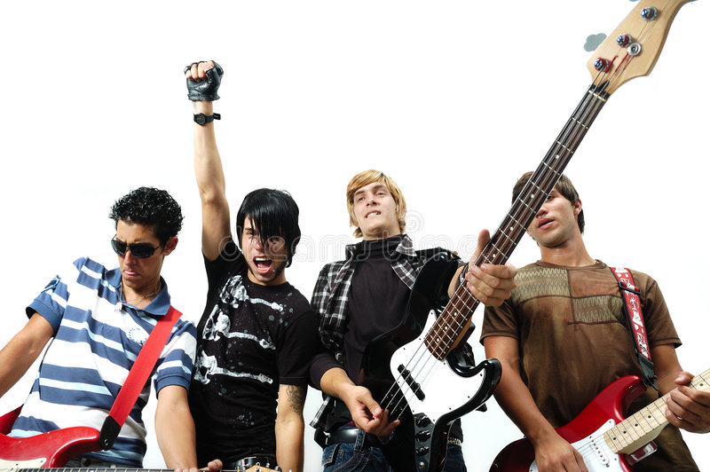 Teen rock band. Portrait of young trendy musicians with attitude - isolated royalty free stock photos
