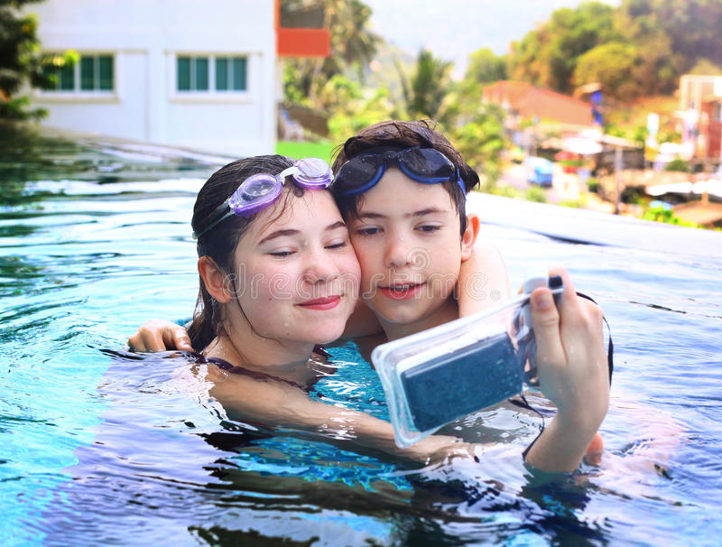 Teen siblings brother and sister stock image image 72689711 - An open air swimming pool crossword clue ...