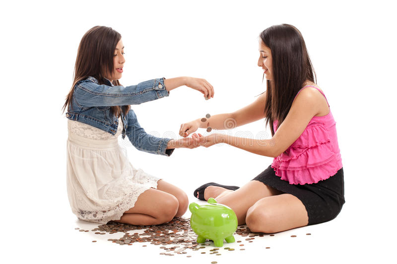 Teen sisters counting money stock photography