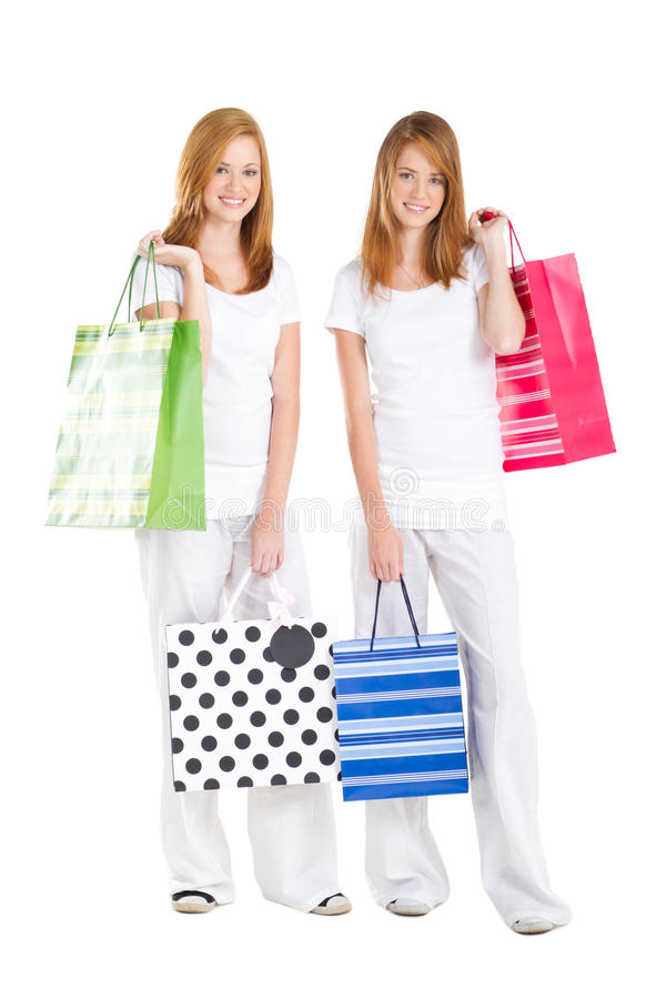Teen sisters shopping stock images