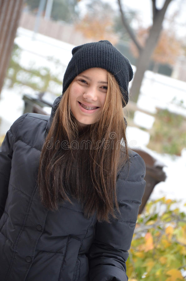 Teen in Snow. Beautiful teenage girl standing outside in the snow royalty free stock photos