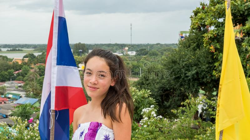 Teen standing in front of thai flag stock photo