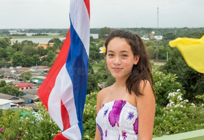 Teen standing in front of thai flag stock photos