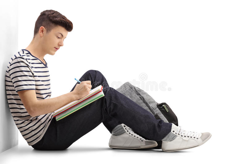 Teen student writing in a notebook stock photos