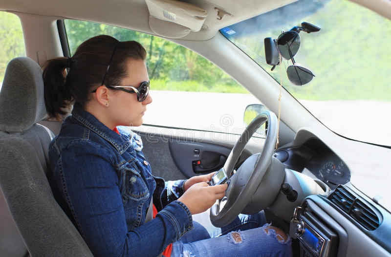 Teen Texting While Driving royalty free stock image