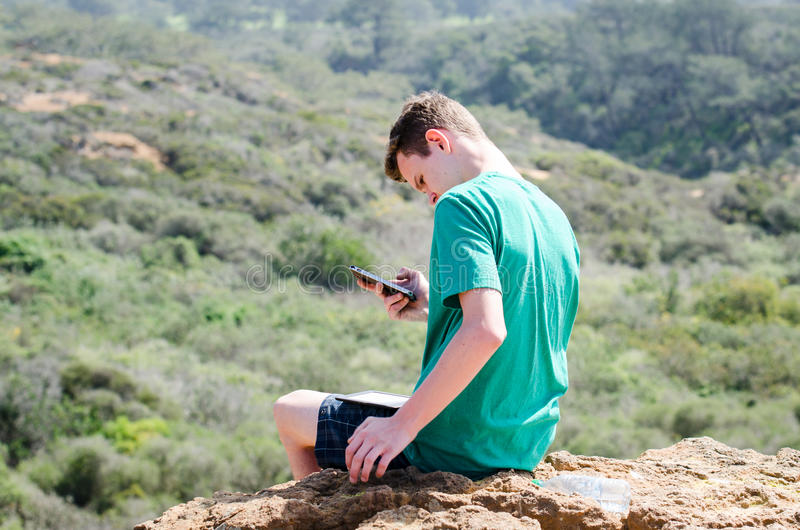 Teen Texting Outdoors royalty free stock images
