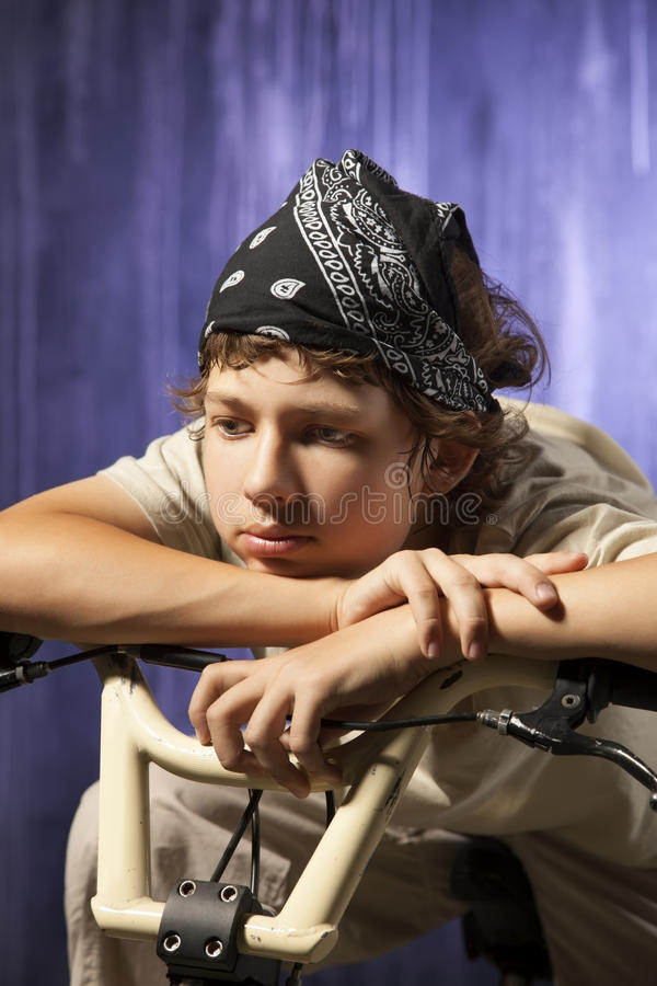 Teen thinking. About life on the background wall of the city stock image