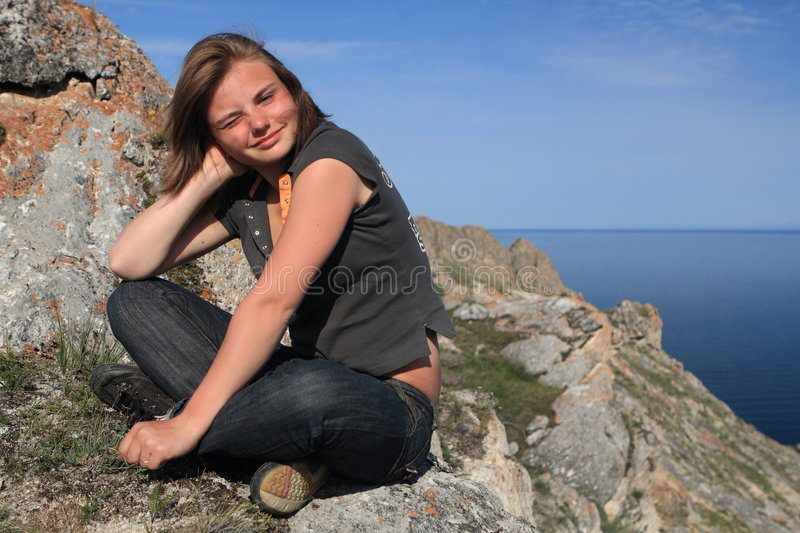 Teen at the top. Of the mountain stock images