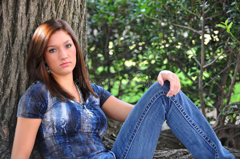 Teen and tree royalty free stock images