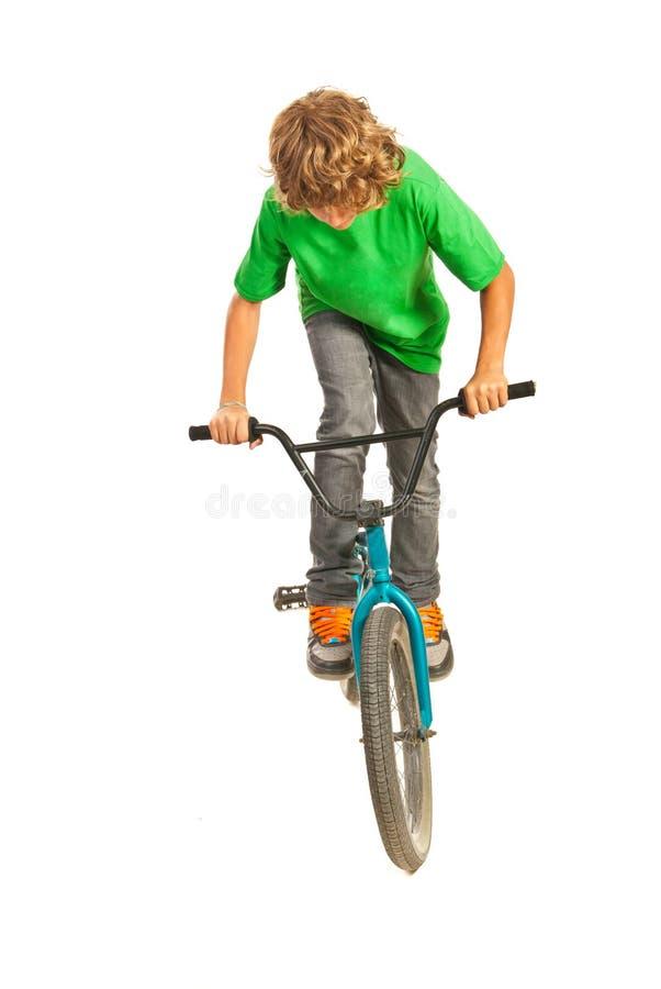 Teen trying a stunt on bike