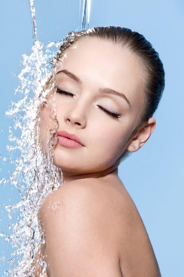 Teen under splash of water royalty free stock images
