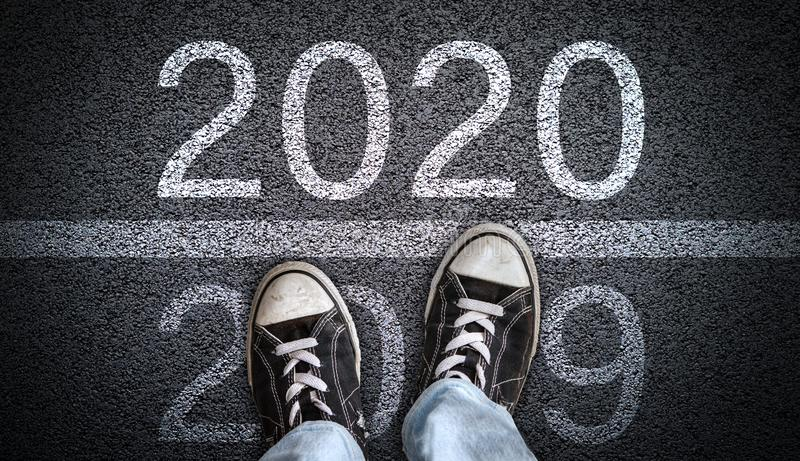Teen Wearing Canvas Shoes Stepping into New Year 2020 stock photography