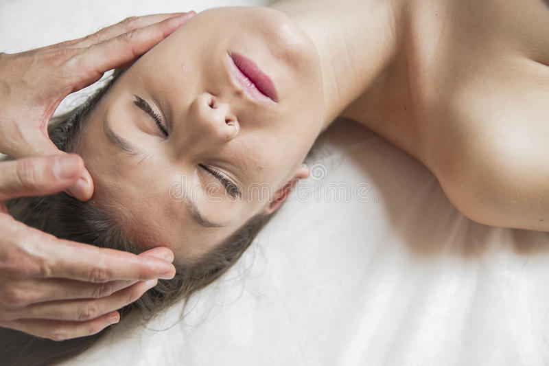 Teen.Wellness - woman receiving body or back massage in spa. Lady.portrait of young beautiful woman in spa environment, wellness stock image
