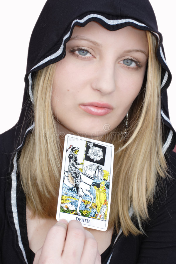 Teen witch with tarot card stock photo