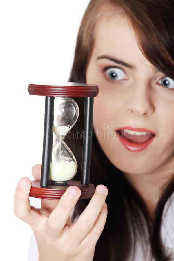 Girl holding an hourglass stock image. Image of glass