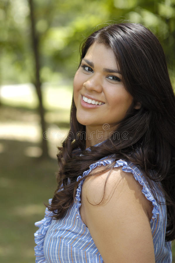 Teen woman in park portrait stock photos