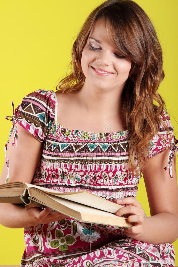 Download Teen woman reading a book stock image. Image of green - 11703325