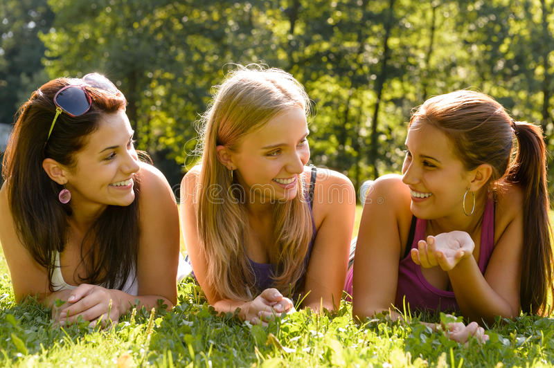 Teen women talking and relaxing in park royalty free stock photos