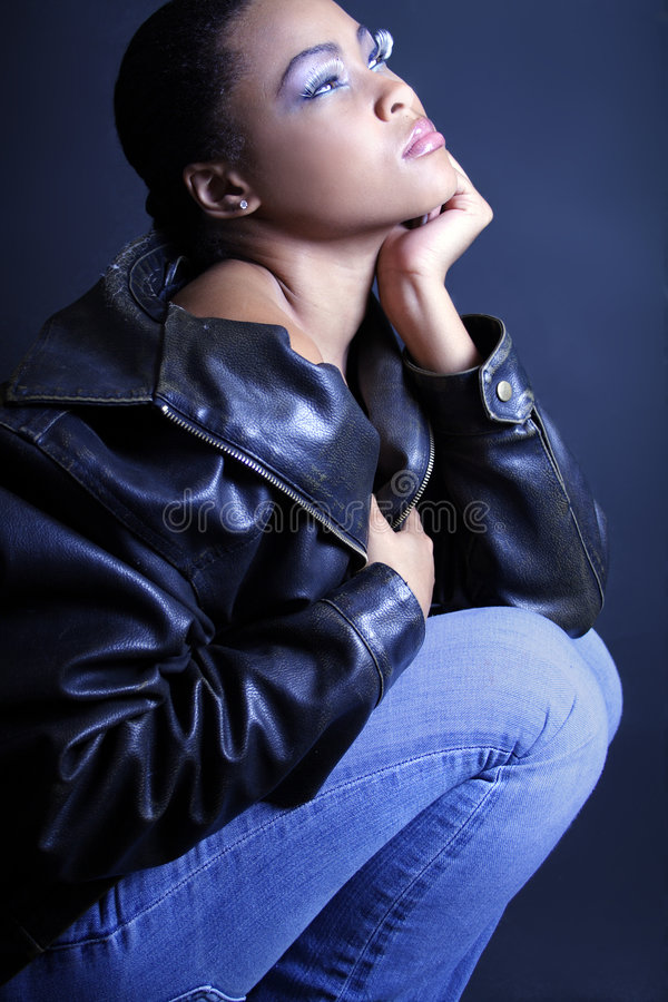 Teenage African American Contemplating and Kneeling royalty free stock photos