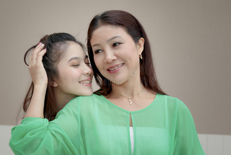 Asian girl hugging and kissing her mother,mother day stock images
