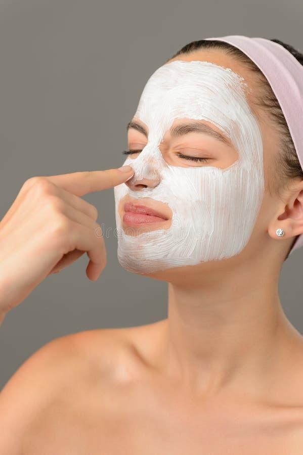 Teenage beauty girl touch nose facial mask stock photos