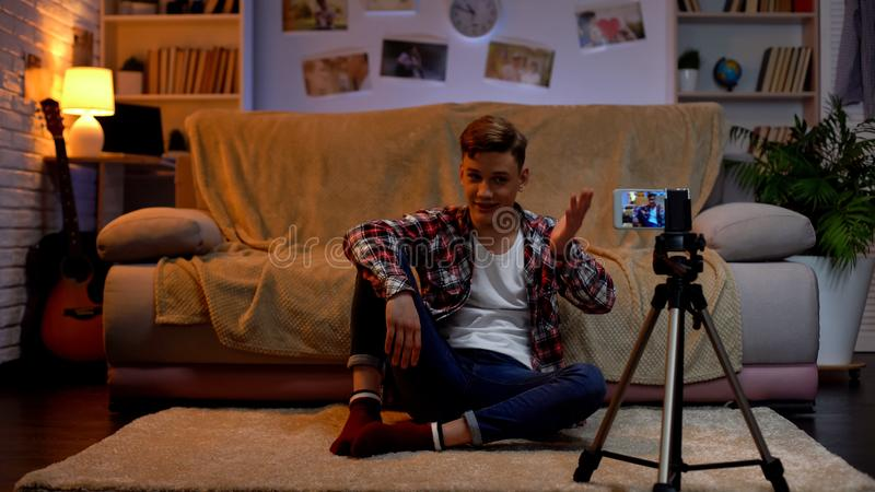 Teenage blogger recording new video on smartphone for his followers, hobby. Stock photo stock photos