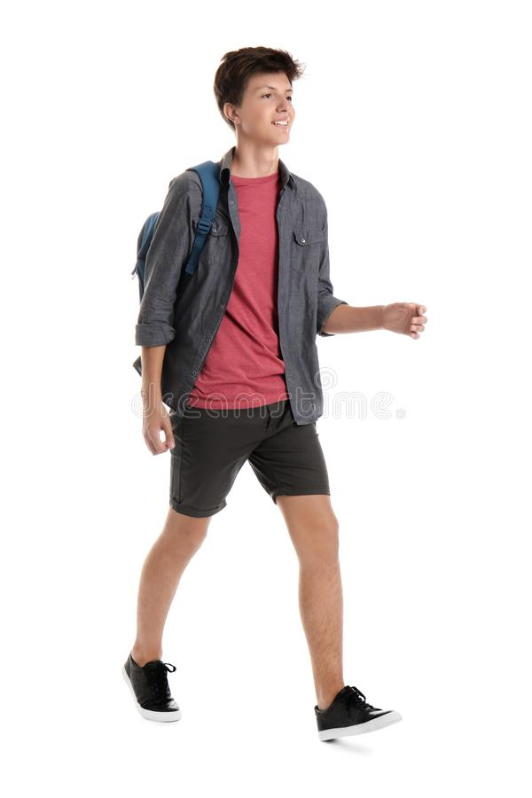 Teenage boy with backpack on white background stock photos