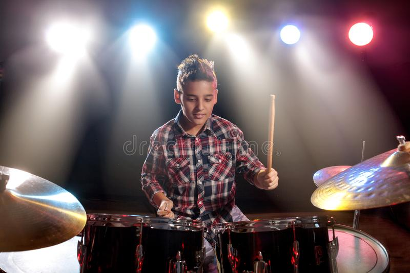 Teenage boy behind drum kit. Boy, learn to play drums royalty free stock photos