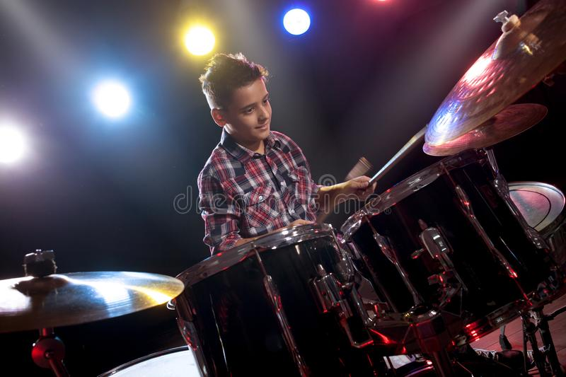 Teenage boy behind drum kit. Boy, learn to play drums stock images