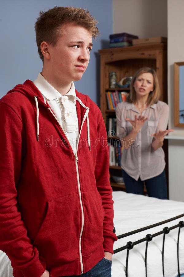 Teenage Boy Being Told Off By Mother. At Home royalty free stock photography